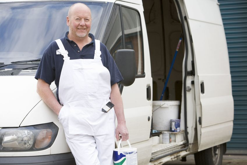 Painter standing by a van